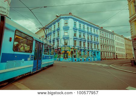 OSLO, NORWAY - 8 JULY, 2015: Tram passing through Grunerlokka neighbourhood next to Birkelunden park