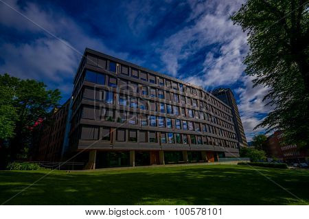 OSLO, NORWAY - 8 JULY, 2015: Office building mid-size located next to park area at Solli Plass