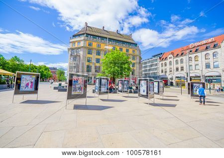 OSLO, NORWAY - 8 JULY, 2015: Plaza in front of Oslo Central station with people around on nice sunny