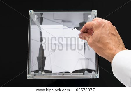 Person Hands Putting Voting Ballot In Box