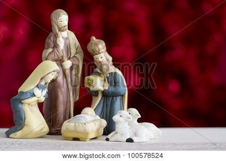 Nativity Scene on Red Background with Copy Space
