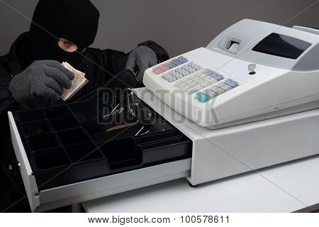 Burglar Stealing Money