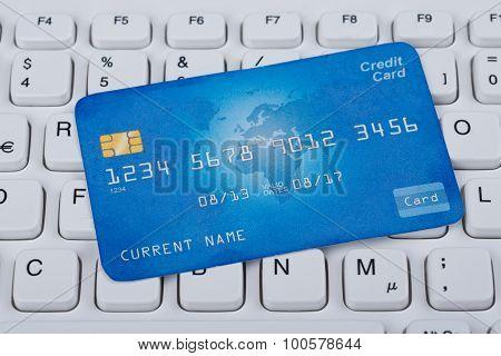 Credit Card Over Computer Keyboard