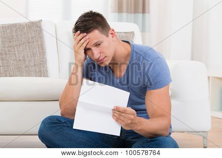 Man Looking At Paper