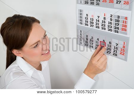 Businesswoman Placing Red Mark On Calendar Date