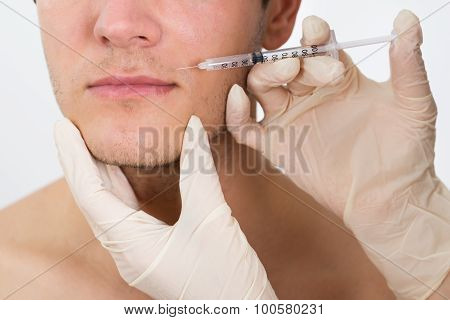 Man Getting Cosmetic Injection In His Face