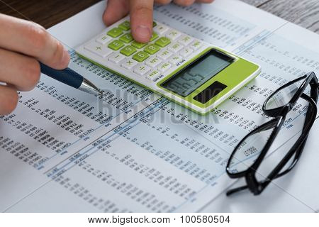 Person Hands Analyzing Accounting Document
