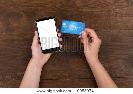 Person Hands With Credit Card And Mobile Phone