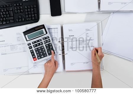 Person Calculating Receipts