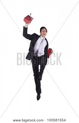 Businessman with a lot of gift packages (isolated in white)