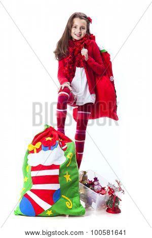 Little girl holding the santa claus bag