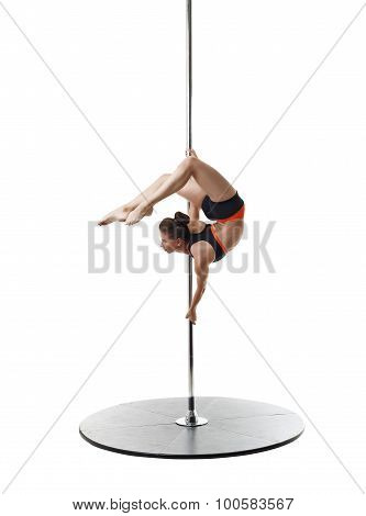 Professional dancer on pylon. Studio photo
