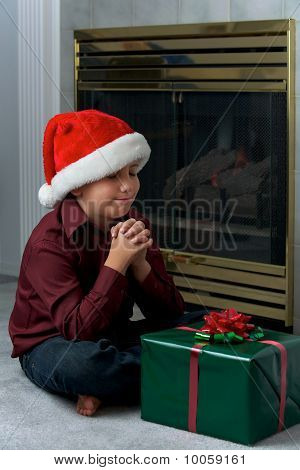 A Boy Praying For Gift