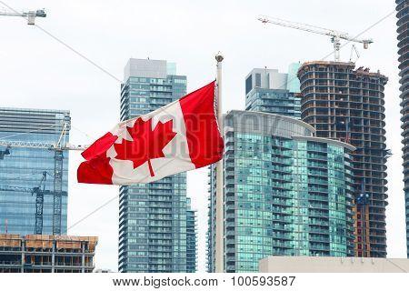 Canadian Flag And Toronto City Skyline