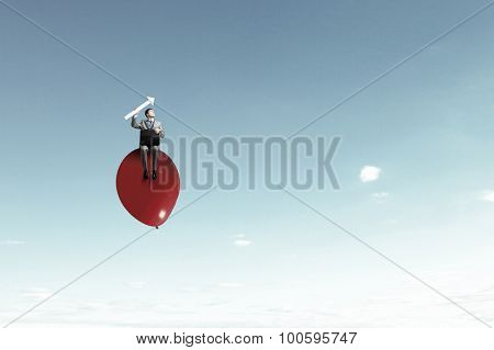 Young handsome businessman with briefcase and arrow in hands