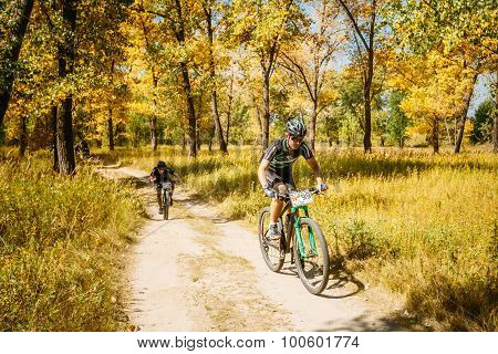 Mountain Bike cyclist riding track at sunny day, healthy lifesty
