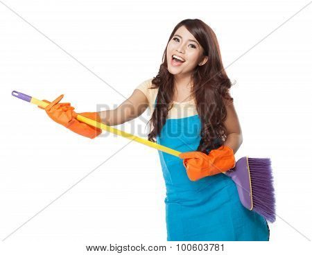 Beautiful Young Asian Woman Holding A Broom, Use It Like A Guita