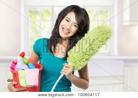 Woman Holding A Basket Full Of Cleaning Products Ready To Do Some Domestic Chores