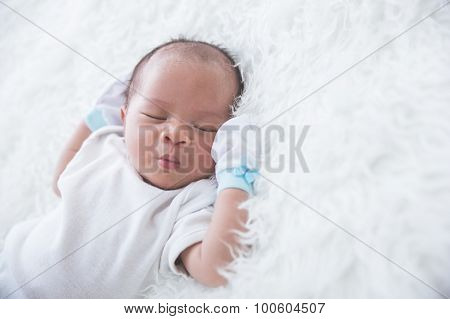 Newborn On The Bed