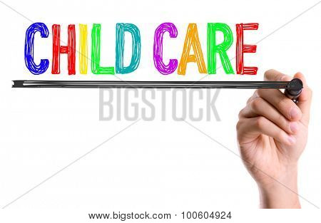 Hand with marker writing the word Child Care