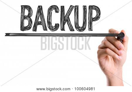 Hand with marker writing the word Backup