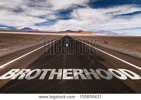 Brotherhood written on desert road