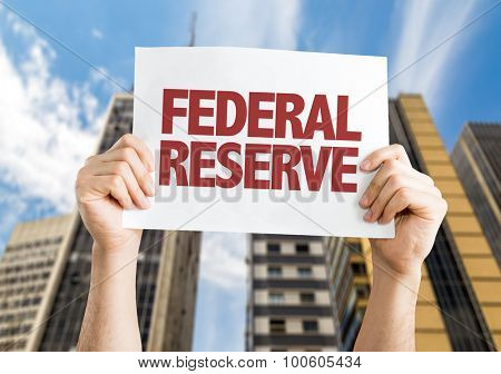 Federal Reserve placard with cityscape background