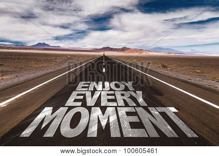 Enjoy Every Moment written on desert road