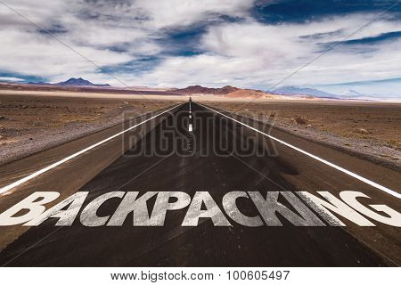 Backpacking written on desert road