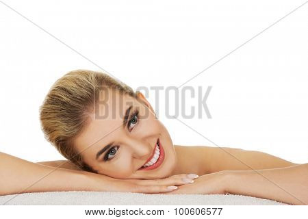 Young beautiful woman based on table, isolated on white