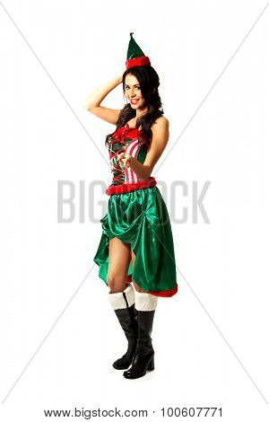 Slim woman wearing elf clothes pointing on you.