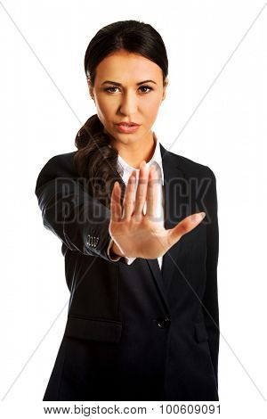 Young businesswoman making stop sign.