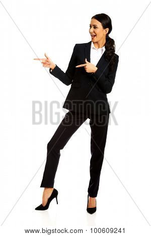 Businesswoman pointing to the left with both hands.