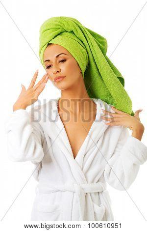Serene spa woman in bathrobe.