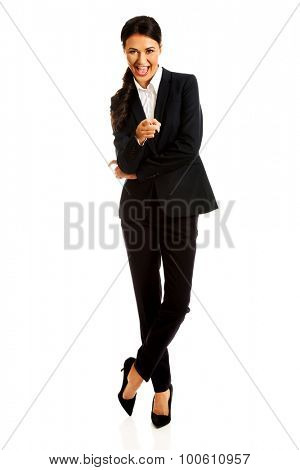 Smiling businesswoman pointing at you.