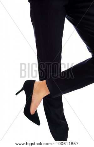Businesswoman slim legs in high heels.