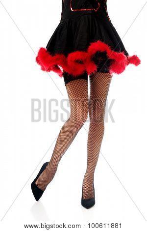 Woman legs wearing devil shoes