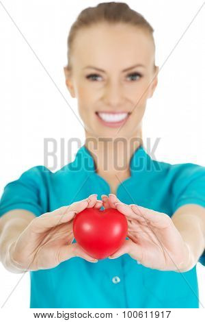 Smiling female doctor with heart.