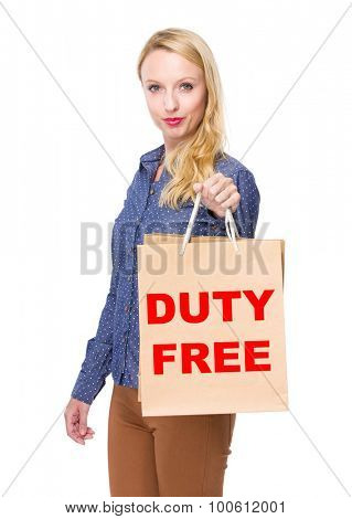 Woman with shopping bag and showing duty free