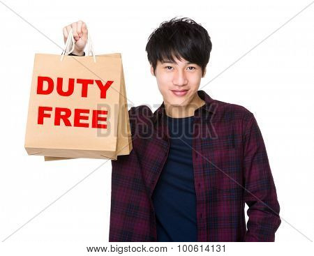 Happy Asian man shopper holding shopping bag for showing phrase of duty free