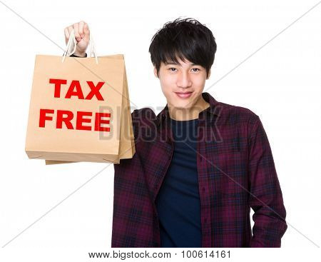 Happy Asian man shopper holding shopping bag for showing phrase of tax free