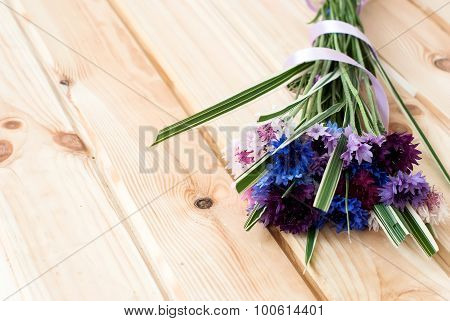 Cornflowers Flowers On A Wooden Background