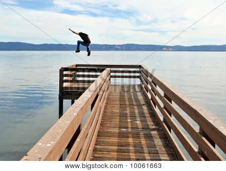 Jumping Off A Pier Into The Ocean