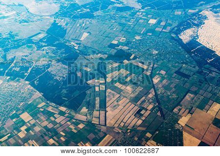 air view on landscape with geometric shaped vegetable gardens