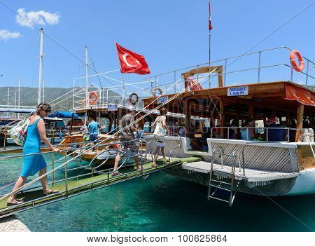 Kemer, Turkey - 06.20.2015. tourists go up the ladder on the boats for excursions in Mediterranean S