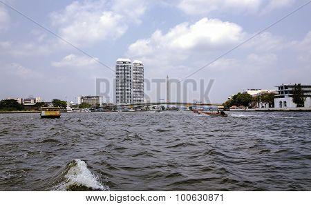 Excursion and pleasure boats sail on Chao Phraya river in Bangkok