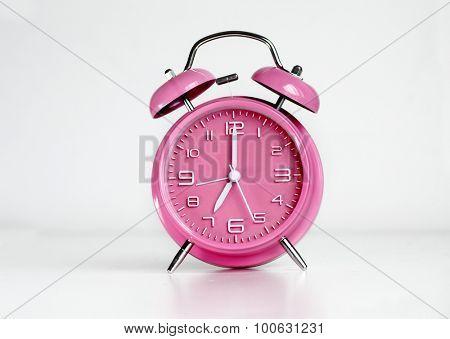 Pink analog retro twin bell alarm clock