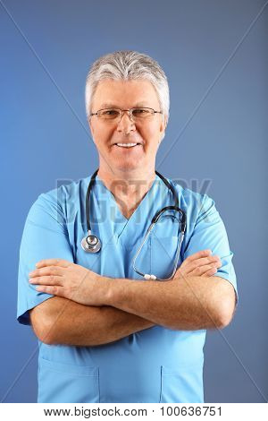 Doctor with stethoscope on colorful background