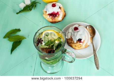 Tea With Mint, Lemon, Cinnamon Stick And Cardamom And Cheese Muffins