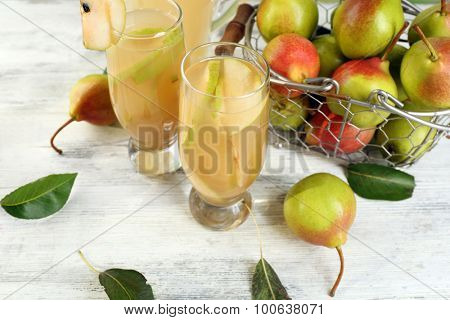 Fresh pear juice with fruit on table close up